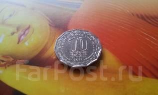 Шри-Ланка. 10 рупий 2011 года. Необычная форма монетки.
