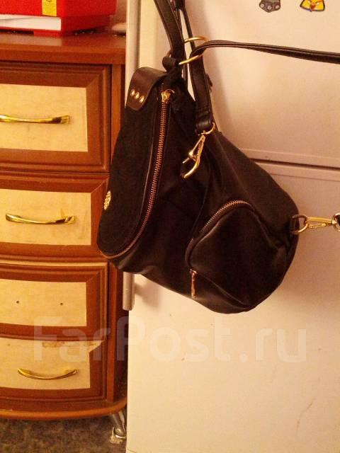 Обмен сумок.