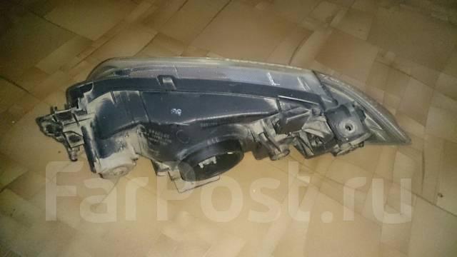 Фара. Mazda Demio, DW3W