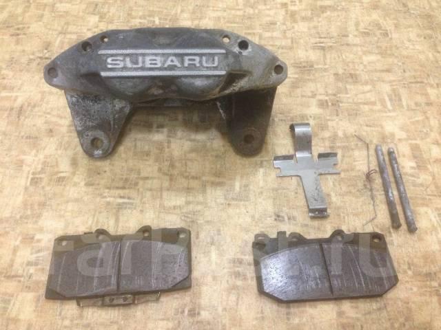 Суппорт тормозной. Subaru