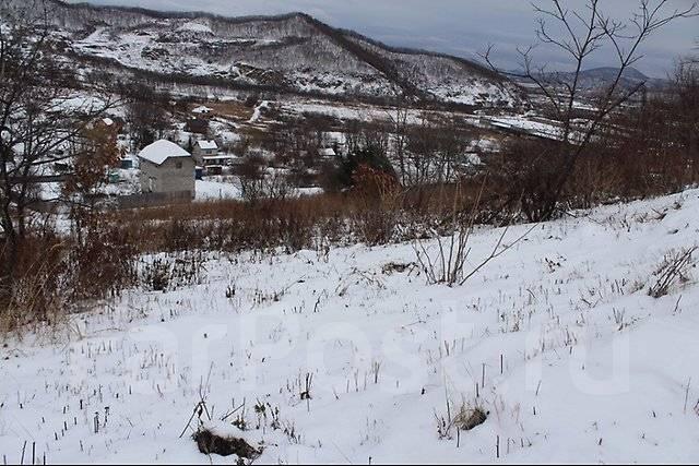 Продам участок в г. Находка. 2 500 кв.м., собственность, электричество, от агентства недвижимости (посредник). Фото участка