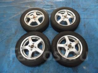 Шины зимние Bridgestone 165/65 R14 с дисками 4*100. 4.5x14 ET45