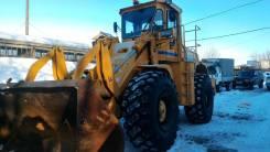 Очистка и уборка снега погрузчиком, большой ковш с загрузкой в самосвал