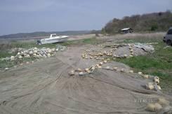1,3 Га, берег, под переработку морепродуктов, стоянку лодок, катеров. 13 001 кв.м., собственность, вода, от агентства недвижимости (посредник). Фото...