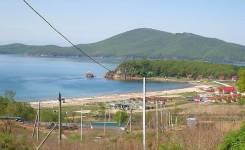 Земля у моря в Фокино возле базы отдыха песочница