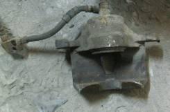 Суппорт тормозной. Nissan Primera, P10