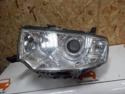 Фара Mitsubishi Pajero Sport, левая