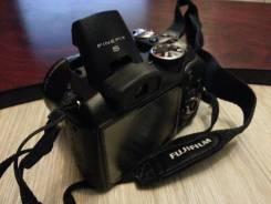 Fujifilm FinePix S2950. 10 - 14.9 Мп, зум: 14х и более