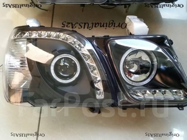 Фара. Toyota Land Cruiser Cygnus, UZJ100W Lexus LX470, UZJ100