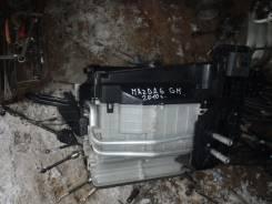 Корпус радиатора отопителя.