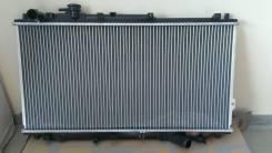 Радиатор охлаждения двигателя. Kia Sephia Kia Shuma