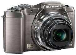 Olympus SZ-14. 10 - 14.9 Мп, зум: 14х и более