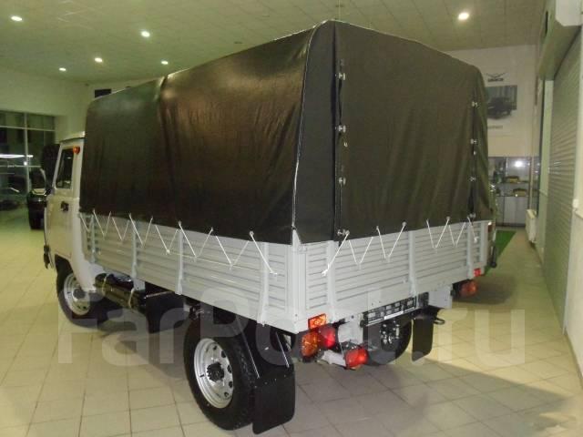 УАЗ 3303 Головастик. УАЗ 3303 Бортовой с тентом, 2 700 куб. см., 1 300 кг.
