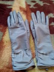 Вчера нашла в автобусе №64 перчатки серого цвета хозяйка отзавись