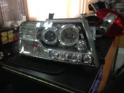Фара. Mitsubishi Pajero, V73W, V75W, V77W, V78W