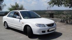 Бампер. Mazda Familia