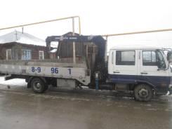 Nissan Diesel. Бортовой грузовик с манипулятором, 6 000 куб. см., 5 000 кг.