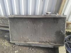 Радиатор охлаждения двигателя. Mazda Familia