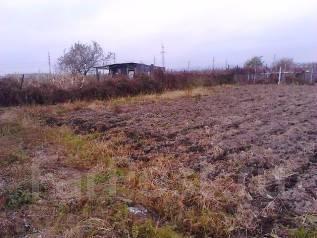 Продаётся земельный участок в Артеме. 1 500 кв.м., собственность, электричество, вода, от агентства недвижимости (посредник). Фото участка