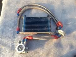 Радиатор масляный. Subaru Mazda Mitsubishi Honda