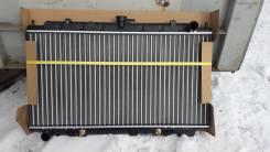 Радиатор охлаждения двигателя. Nissan Primera Camino, WHNP11, P11, WHP11, HP11 Nissan Bluebird, EU14, HU14, ENU14 Двигатели: SR18DE, SR20DE, SR18DI