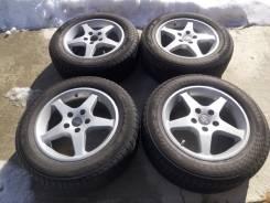 Комплект отличного литья с шинами 215/60/16 Yokohama AC02 C. Drive 2. 7.0x16 5x114.30 ET42 ЦО 67,1мм. Под заказ