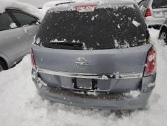 Бампер Opel Astra H Wagon задний