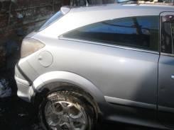 Щит опорный задний правый Opel Astra H