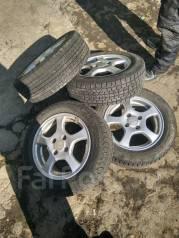 Комплект зимних колес 175/65/14 на литье Enkei Modulo с рубля. 5.5x14 4x100.00 ET45 ЦО 60,0мм.