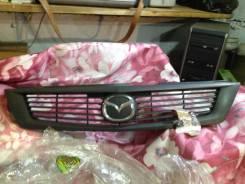 Эмблема решетки. Mazda Familia