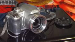 Panasonic Lumix DMC-FZ28. 10 - 14.9 Мп, зум: 14х и более
