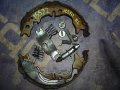 Механизм стояночного тормоза Toyota Crown, левый задний 4654051010