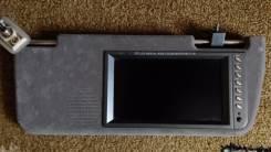 Телевизор-монитор в солнцезащитном козырьке.