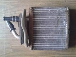 Радиатор отопителя. Mazda 323