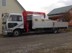 Nissan Diesel. Самогруз, 7 700 куб. см., 6 000 кг.