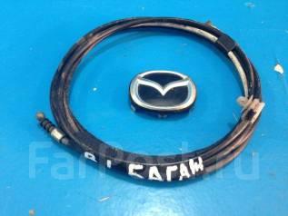 Тросик багажника. Mazda Protege Mazda Familia, BJ3P, BJ5P, BJ5W, BJ8W, BJEP, BJFP, BJFW Mazda 323 Двигатели: ZL, ZLDE, ZLVE