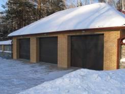 Подъемно-секционные гаражные ворота от ведущих производителей. Под заказ