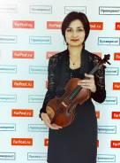 Обучение игре на скрипке.