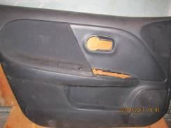 Обшивка двери. Nissan Note