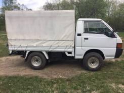 Mitsubishi Delica. Продается грузовик Митсубиси делика в очень хорошем состоянии, 2 400 куб. см., 1 300 кг.