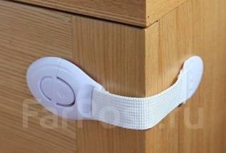 Гибкий фиксатор на дверцы/ящики . безопасность
