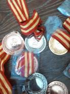 Продам медали новые