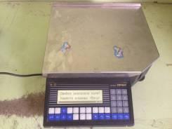 Весы с печатью этикеток.