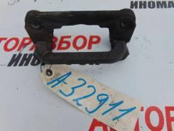 Скоба суппорта заднего правого Nissan Tiida (C11)