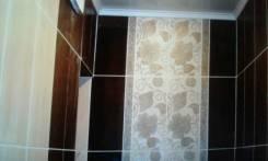 Укладка плитки фартуки, пол и стены