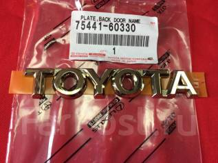 Эмблема багажника. Toyota Land Cruiser, UZJ100W, UZJ100, HZJ105, FZJ100, UZJ100L, FZJ105, HZJ105L Двигатели: 1FZFE, 2UZFE, 1HZ