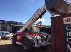 MST. Телескопический погрузчик (МСТ) с вилами и ковшом, 2 000 куб. см., 3 000 кг.