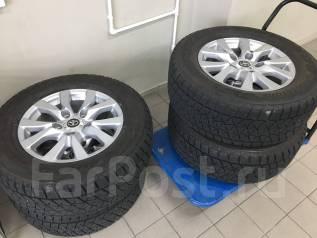 Продам новые оригинальные колеса Toyota LC200 R18 на зимней резине. x18 5x150.00