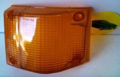 Стекло габарита ISUZU ELF 89-93 арт 2131614 L=R темно-желтое