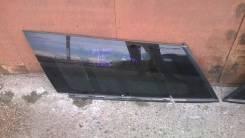 Спойлер на заднее стекло.